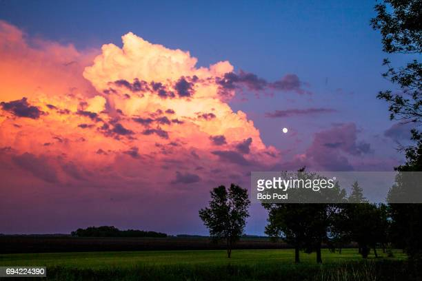 Moonrise and storm clouds at sunset in a rural area near Grafton, ND
