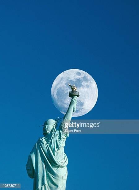 Moonrise near Statue of Liberty.