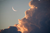 Moonrise with evening clouds