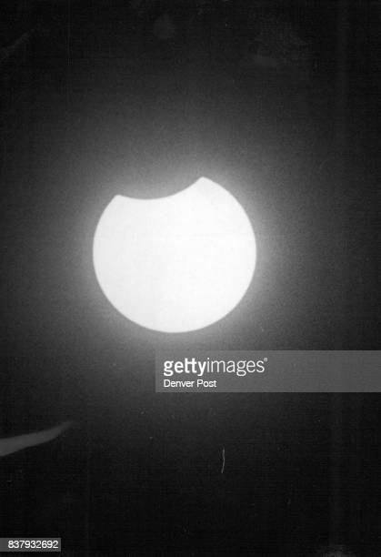 Moon's Shadow Takes Bite Into Bright Sun Watchers in Denver saw the moon's shadow bite into the sun's bright disc Thursday starting at 1213 pm The...