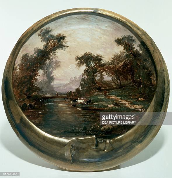 Moonshaped plate with landscape ceramic painted at the third firing France 19th century