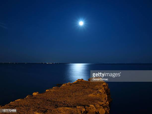 Moonshine seascape and old jetty