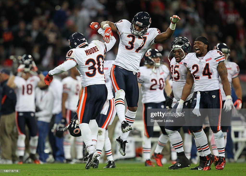 D.J. Moore #30 of the Chicago Bears celebrates Anthony Walters #37 of the Chicago Bears after he makes a game winning interception during the NFL International Series match between Chicago Bears and Tampa Bay Buccaneers at Wembley Stadium on October 23, 2011 in London, England. This is the fifth occasion where a regular season NFL match has been played in London.