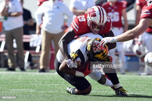 J Moore of the Maryland Terrapins is tackled by Dontye CarriereWilliams of the Wisconsin Badgers at Camp Randall Stadium on October 21 2017 in...