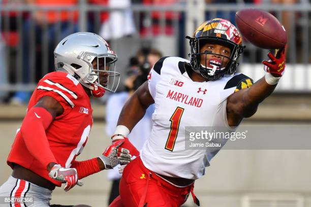 J Moore of the Maryland Terrapins reaches but can't make the catch on a fourth down pass attempt in front of Kendall Sheffield of the Ohio State...