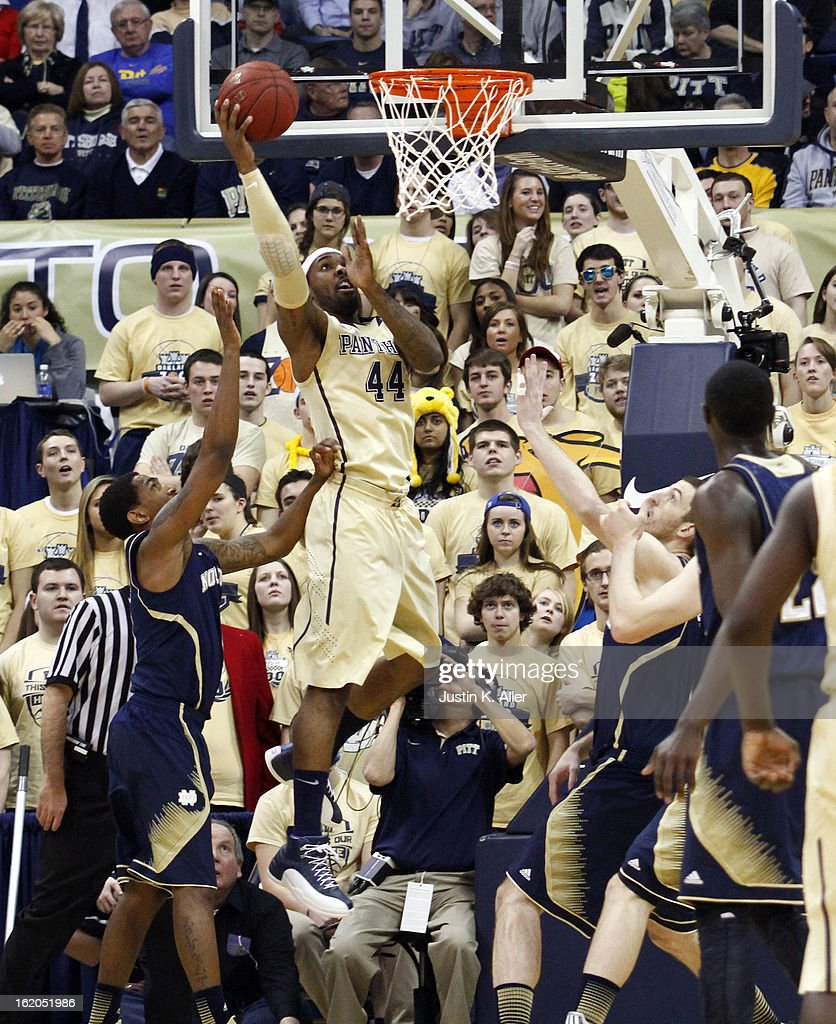 J.J. Moore #44 of the Pittsburgh Panthers attempts a layup against the Notre Dame Fighting Irish at Petersen Events Center on February 18, 2013 in Pittsburgh, Pennsylvania.