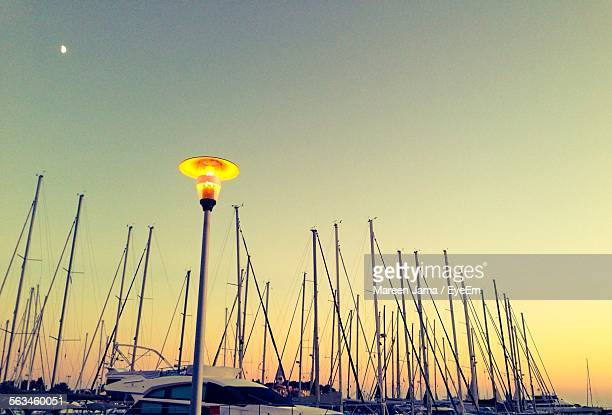 Moored Boats And Lamp Post Against Clear Sky