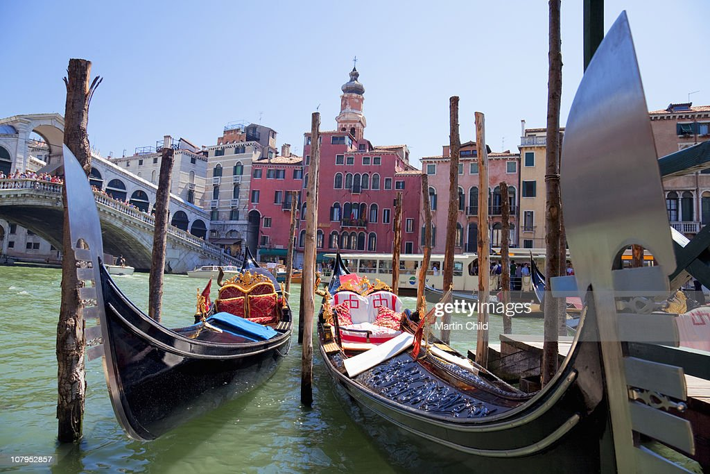Moored gondolas near Rialto Bridge in Venice : Stock Photo