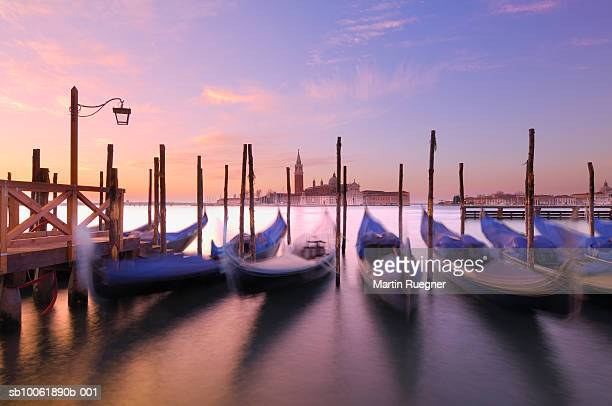 Moored gondolas on Grand Canal, with church San Giorgio Maggiore in background.