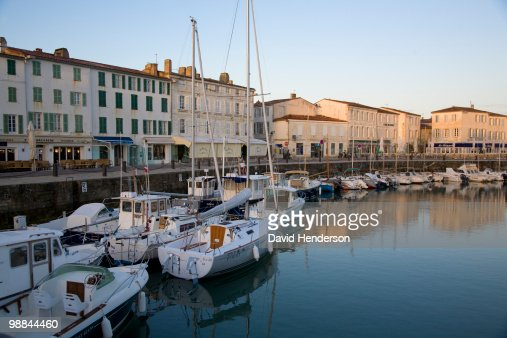 Moored sailboats on waterfront, St. Martin, Ile de Re, France : Stock Photo
