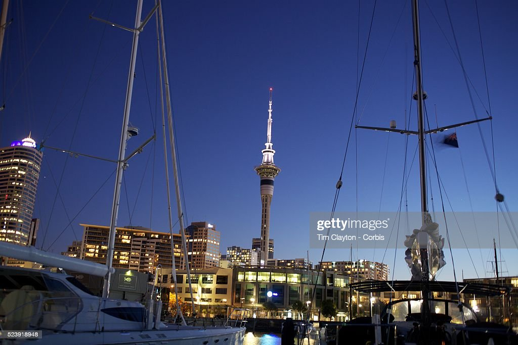 Moored yachts in Viaduct Basin showing Sky Tower in the background Auckland New Zealand Located in the heart of Auckland City Viaduct Basin and...