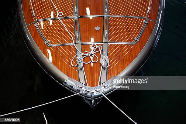 Mooring lines sit on the polished wooden deck of a Riva Rivarama Super luxury yacht manufactured by Ferretti Group inside the company's shipyard in...