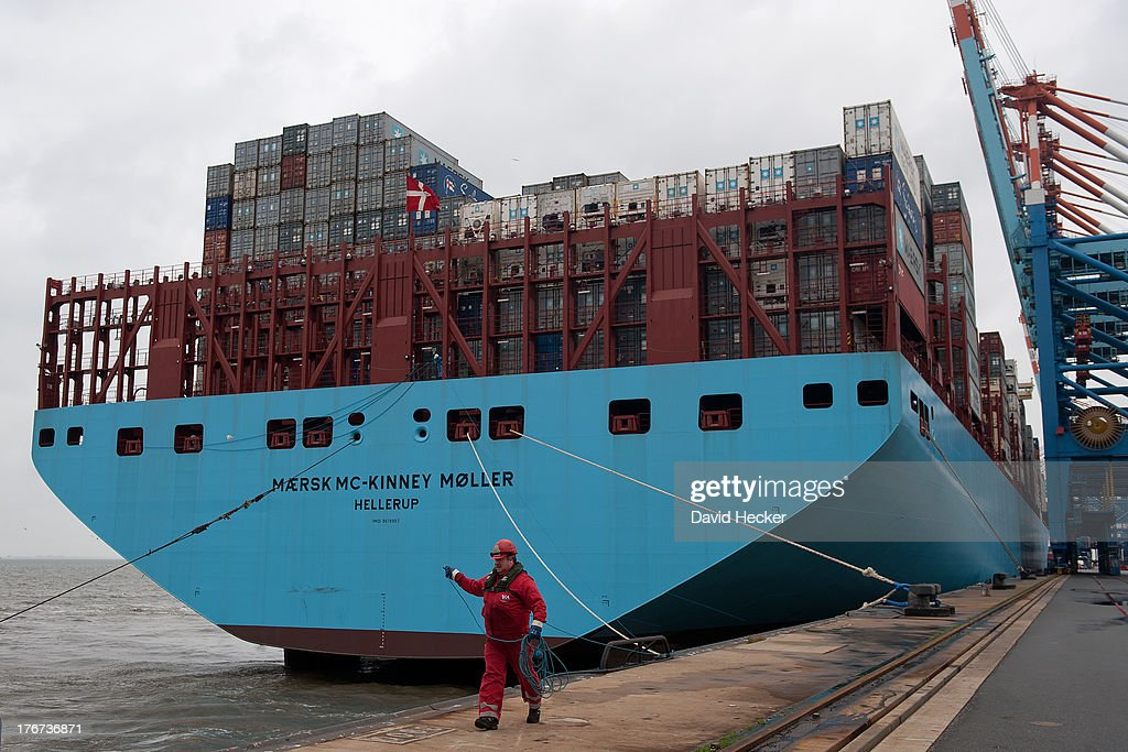 A mooring takes the lines of the world's biggest container ship, the Maersk MC-Kinney Moller at the port of Bremerhaven on August 18, 2013 in Bremerhaven, Germany. The world's largest container ship, the Maersk MC-Kinney Moller, arrives at the port of Bremerhaven on Sunday. It has a length of 400 meters, it is 59 meters wide and is capable of delivering 18.000 TEU Container. The ship carries the first Triple-E Standard (Economy of Scale, Energy Efficiency, Environmentally-improved) and is the most efficient and energy saving container ship in the world.