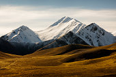 Moorland and snow capped mountains at Lindis Pass, South Island, New Zealand