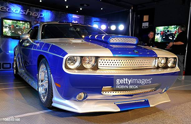 A Moparmodified 2010 Dodge Challenger with a 451 cid HEMI allaluminum Gen III engine assembly by Rich Evans Designs is on display at the 2010...
