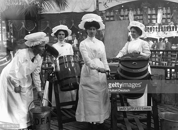 Mopcapped dairy maids with butter churns and pails