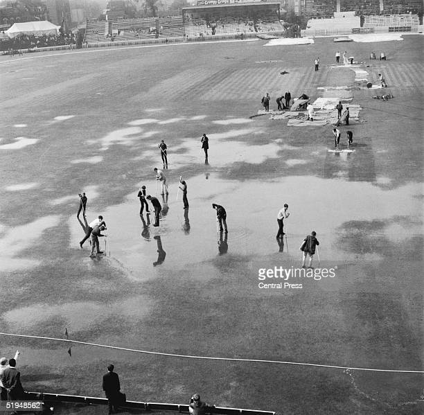 Mopping up operations begin at the Oval Kennington London after a thunderstorm interrupted the third and final test between England and Australia...