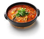 moqueca capixaba, brazilian fish stew isolated on white background