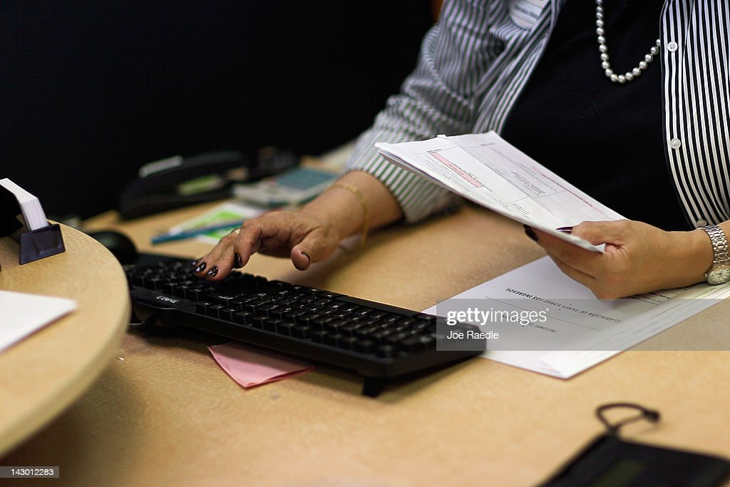 Moraiba Mata a tax professional at HR Block inputs clients tax information on April 17 2012 in Miami Florida Today is the last day to file taxes...