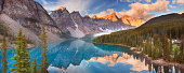 Beautiful Moraine Lake in Banff National Park, Canada. Photographed at sunrise. A seamlessly stitched panoramic image.