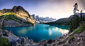 The emerald waters of Moraine Lake at sunset.  A panoramic photo.