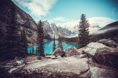The crystal clear blue water of Moraine Lake surrounded by the Canadian Rockies. Banff National Park, Alberta.