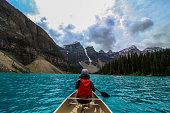 Canoeing the pretty waters of Moraine Lake, in Banff National Park, Alberta, Canada.