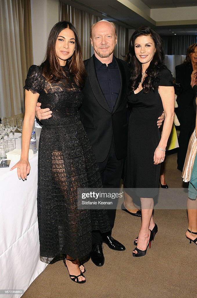 Moran Atias, director Paul Haggis and actress Catherine Zeta Jones attend the Grey Goose cocktail reception of The Film Society of Lincoln Center's 40th Chaplin Award Gala at Avery Fisher Hall, Lincoln Center on April 22, 2013 in New York City.