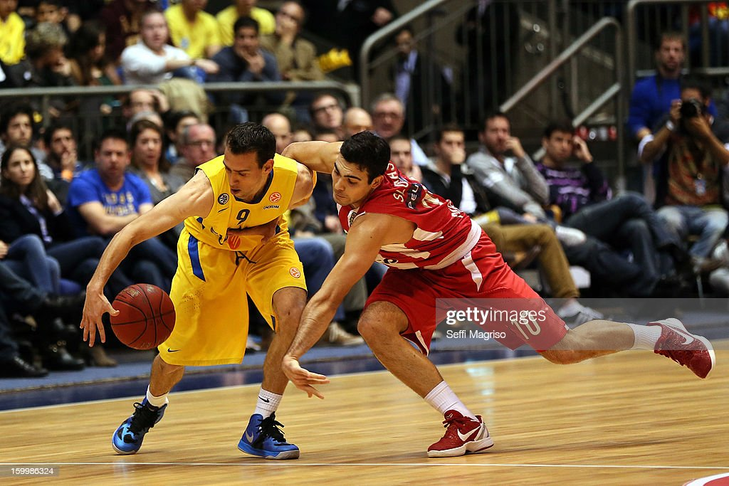 Moran Roth, #9 of Maccabi Electra Tel Aviv competes with Kostas Sloukas, #10 of Olympiacos Piraeus in action during the 2012-2013 Turkish Airlines Euroleague Top 16 Date 5 between Maccabi Electra Tel Aviv v Olympiacos Piraeus at Nokia Arena on January 24, 2013 in Tel Aviv, Israel.