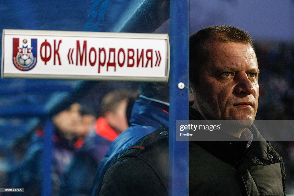 FC Mordovia Saransk head coach Dorinel Munteanu looks on during the Russian Football League Championship match between FC Zenit St. Petersburg and FC Mordovia Saransk at the Petrovsky Stadium on March 17, 2013 in St. Petersburg, Russia.