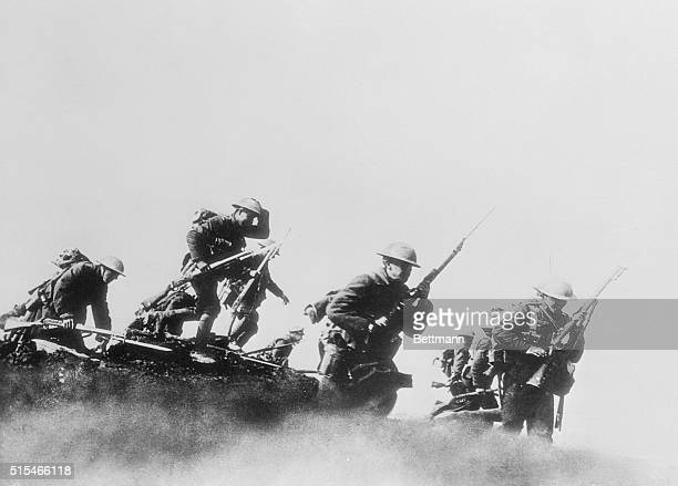 More Canadians step overOut of the trenches and into the enemy's range go these Canadian troops ready for combat and scornful of the bullets and...