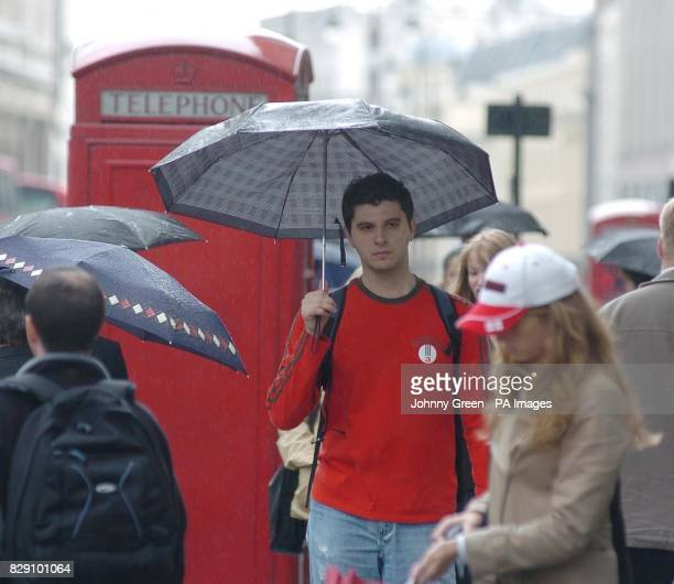 More rain hits the capital as shoppers on The Strand in central London take measures to stay dry This time last year Britain basked in blistering...