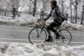 More snow fell on Boston as the storm that wreaked havoc in the American South made its way to New England A cyclist braved Tremont Street by the...