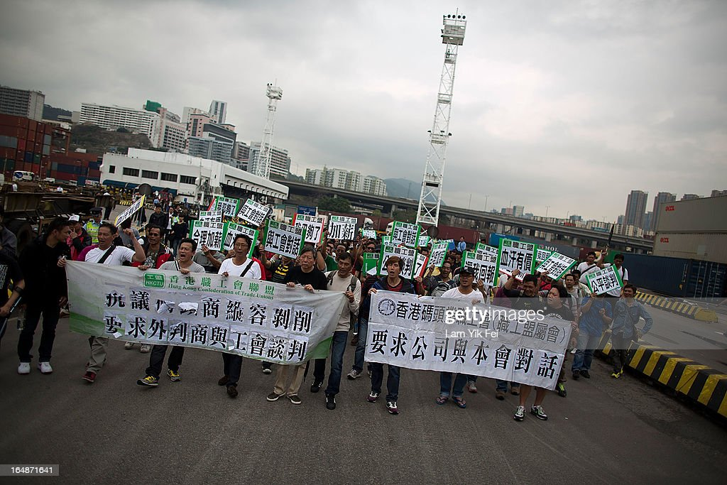 More than 100 dock workers stage a protest over pay at the Kwai Chung Container Terminal on March 29, 2013 in Hong Kong, China. The workers, who are employed by Hongkong International Terminals, are demanding higher wages, noting that they have not received a pay raise in 15 years.