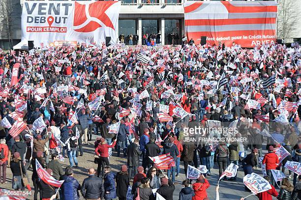 More than 10000 people gather on January 24 in Brest northwestern France during a demonstration to maintain their jobs at the Credit Mutuel Arkea...