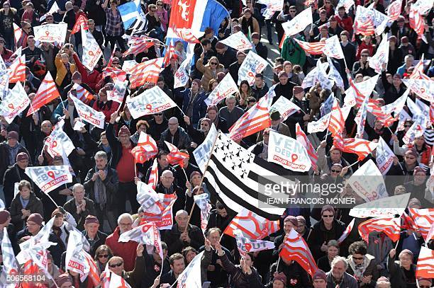 More than 10000 people holding banners reading 'Headwind for employment' and a Breton flag gather on January 24 in Brest northwestern France during a...