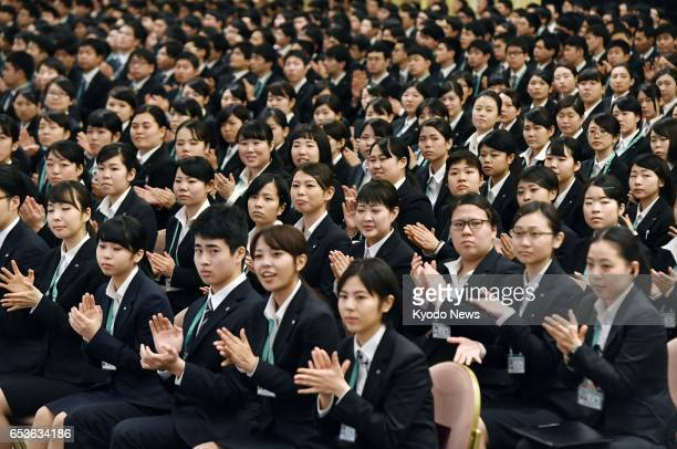 More than 1200 new recruits of 22 group companies of retail giant Seven amp i Holdings Co attend a welcoming ceremony at a hotel in Tokyo on March 16...