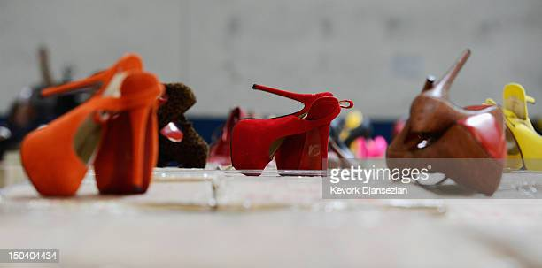 More than 20000 pairs of counterfeit Louboutin pumps and high heels featuring the distinctive red sole of French designer Christian Louboutin are...