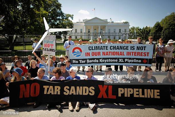 More than 50 demonstrators sit down in front of the White House along Pennsylvania Avenue while protesting against a proposed pipeline that would...