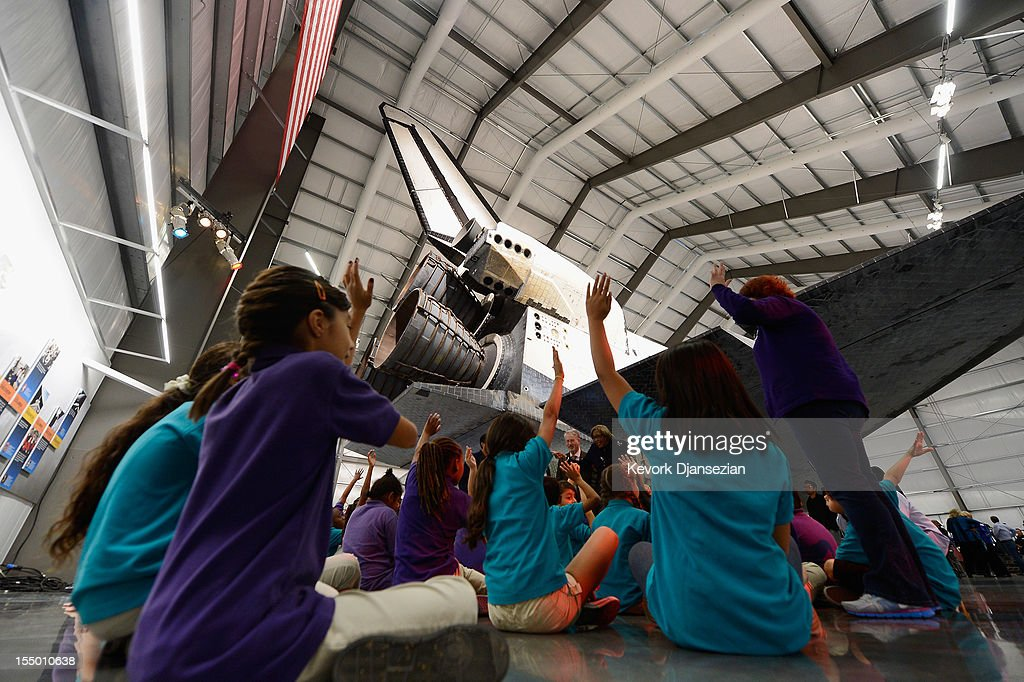 More than 500 California Science Center School students attend the space shuttle Endeavour exhibit grand opening ceremony at the new Samuel Oschin Pavilion of the California Science Center on October 30, 2012 in Los Angeles, California. The Orbiter arrived in Los Angeles in late September atop a modified Boeing 747. Then earlier this month nearly 1 million spectators looked on as Endeavour was transported on city streets during a three-day 11-mile journey from Los Angeles International Airport to the Science Center.