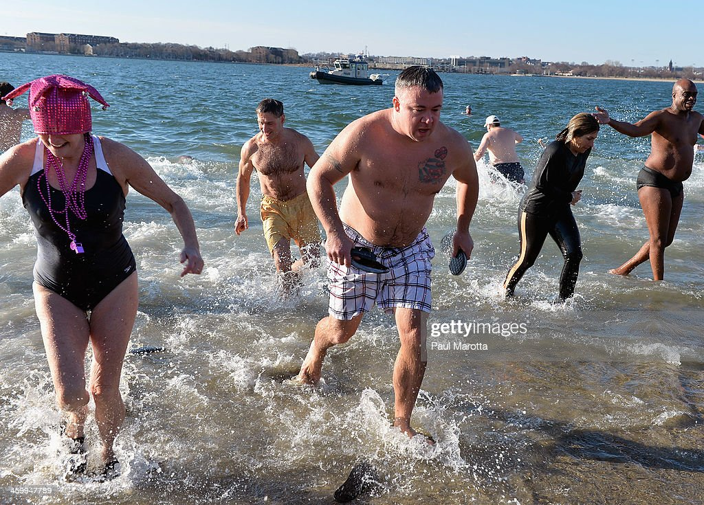 More than 600 swimmers brave the 19 degree Fahrenheit (-7 degree Celsius) air temperature to participate in the L Street Brownies annual New Year's Day Boston Polar Plunge 2014 at the Carson Beach L Street Bathhouse at Curley Community Center, begun in 1904, on January 1, 2014 in Boston, Massachusetts.