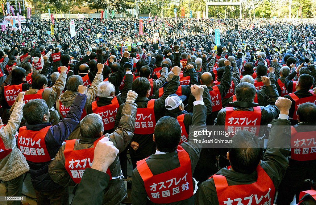 More than a hundred Okinawa citizens including local government officials hold fists in the air in a protest rally against deployment of the U.S. Marines' MV-22 Osprey aircraft, at Hibiya Park on January 27, 2013 in Tokyo, Japan.