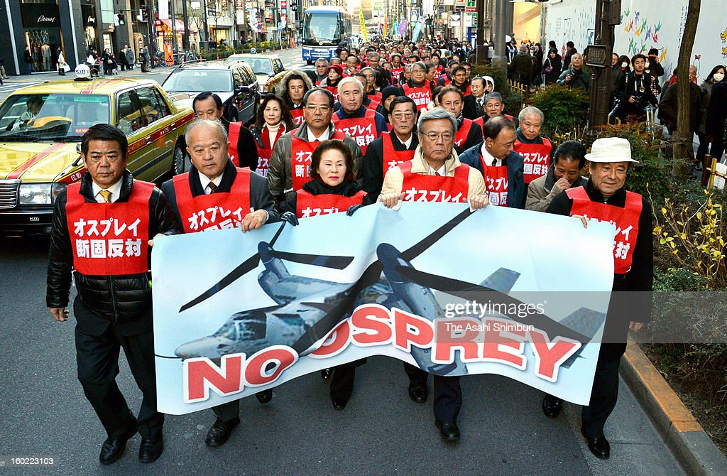 More than a hundred Okinawa citizens including local government officials march on in a protest rally against deployment of the U.S. Marines' MV-22 Osprey aircraft at Tokyo's high street of Ginza on January 27, 2013 in Tokyo, Japan.