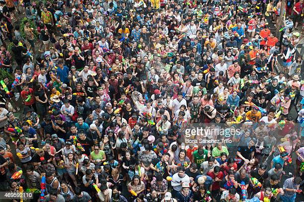 More than a thousand people take part in a water fight during the Songkran water festival in Silom Road on April 13 2015 in Bangkok Thailand The...