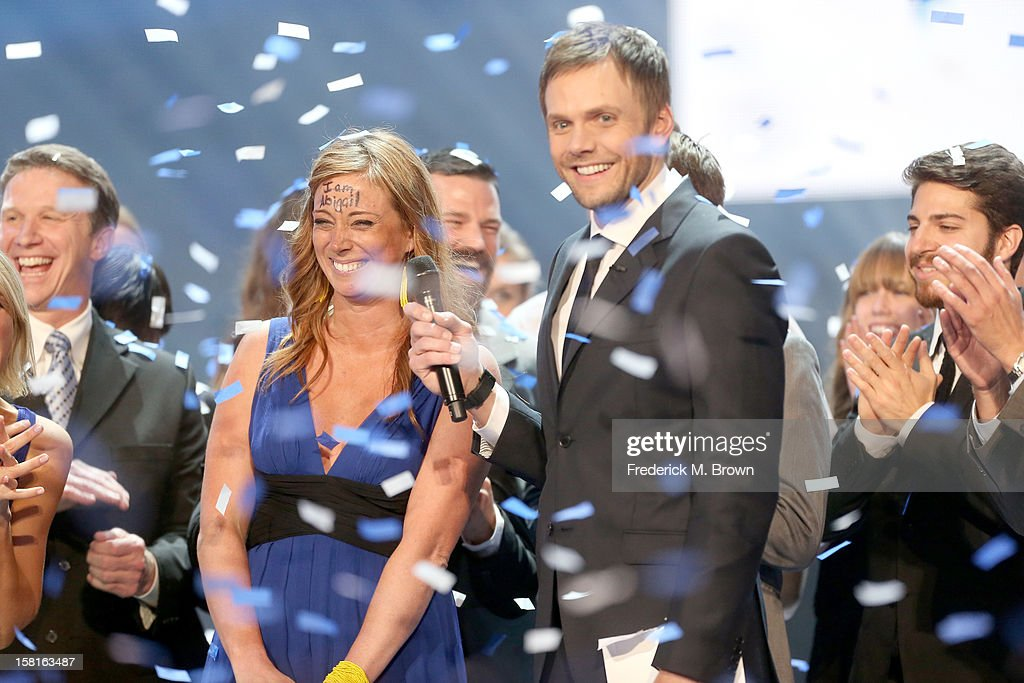 'More Than Me' foundation founder Katie Meyler and host <a gi-track='captionPersonalityLinkClicked' href=/galleries/search?phrase=Joel+McHale&family=editorial&specificpeople=754384 ng-click='$event.stopPropagation()'>Joel McHale</a> onstage at the American Giving Awards presented by Chase held at the Pasadena Civic Auditorium on December 7, 2012 in Pasadena, California.