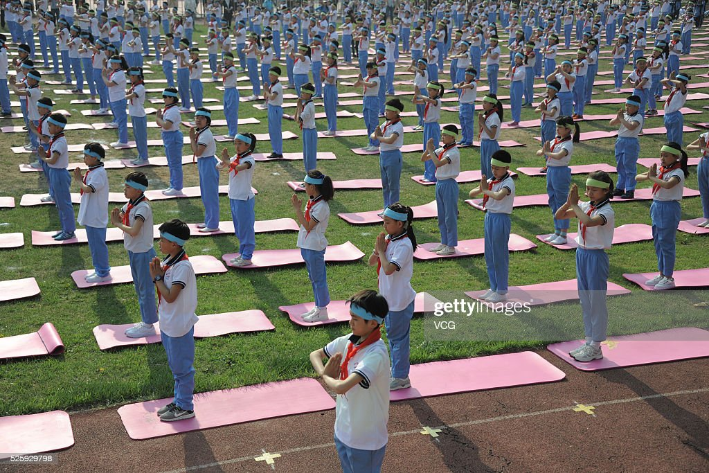More than one thousand primary students do yoga at a sports meeting in a primary school on April 29, 2016 in Jinan, Shandong Province of China. Different from former sports meetings in the school, it's said that every student became a real participant this time.