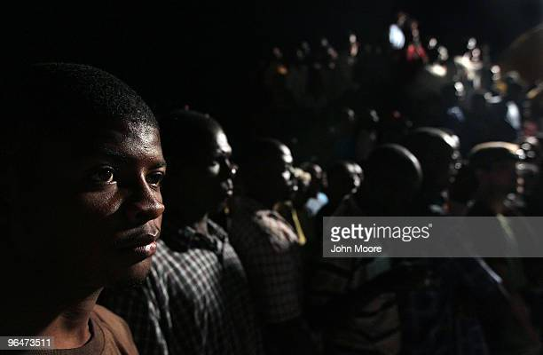 More than three weeks after Haiti's devastating earthquake people watch as as a French rescue team searches for a survivor on February 6 2010 in...