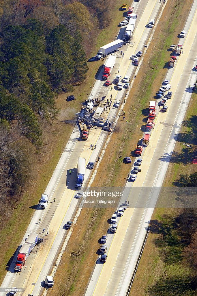 More than two dozen vehicles collided in a fiery pileup on a foggy Georgia interstate on Wednesday, February 6, 2013, killing at least three people and leaving several others hurt, officials said. The vehicles included were six commercial vehicles and an empty petroleum tanker truck, which ruptured and caught fire, the patrol said.