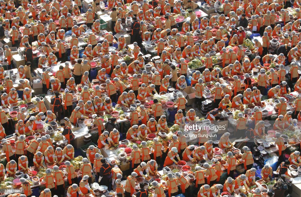 More than two thousand housewives make Kimchi for donation to the poor in preparation for winter in front of City Hall on November 15, 2012 in Seoul, South Korea. Kimchi is a traditional Korean dish of fermented vegetables usually mixed with chili and eaten with rice or served as a side dish to a main meal.
