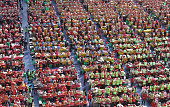 More than two thousand South Koreans make Kimchi to donate to the poor in preparation for the winter at the City Hall of Seoul on November 14 2014 in...